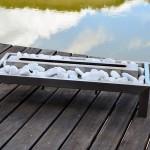 Lareira Pedra Jardim - Largura: 70 cm | Altura: 20 cm | Profundidade: 30 cm | Material: Inox e pedras de jardim